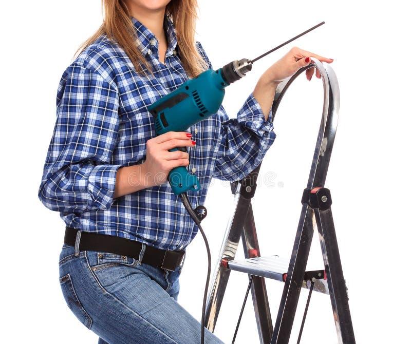 Женщина держит сверло стоковое изображение