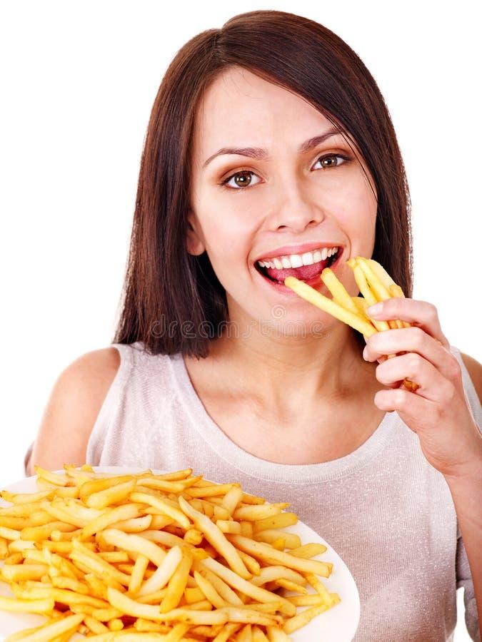 Женщина есть fries франчуза. стоковое изображение rf