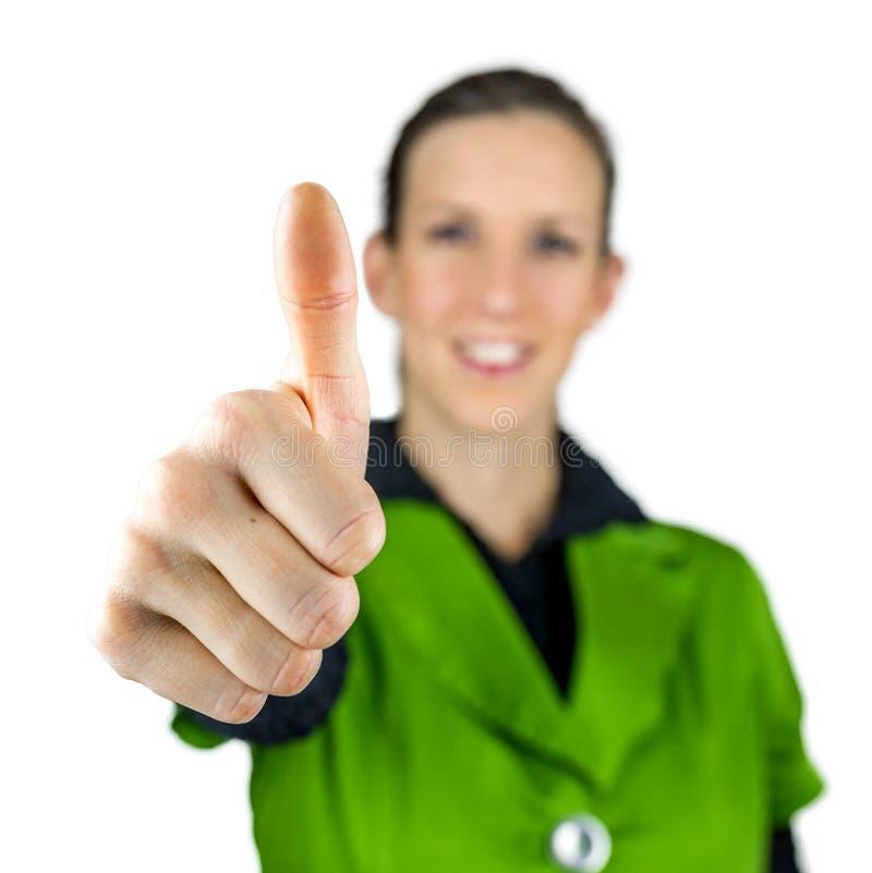 Женщина делая большие пальцы руки поднимает знак стоковые изображения rf