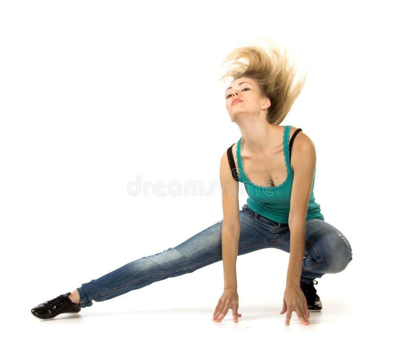 Женщина делая протягивающ тренировку стоковые изображения