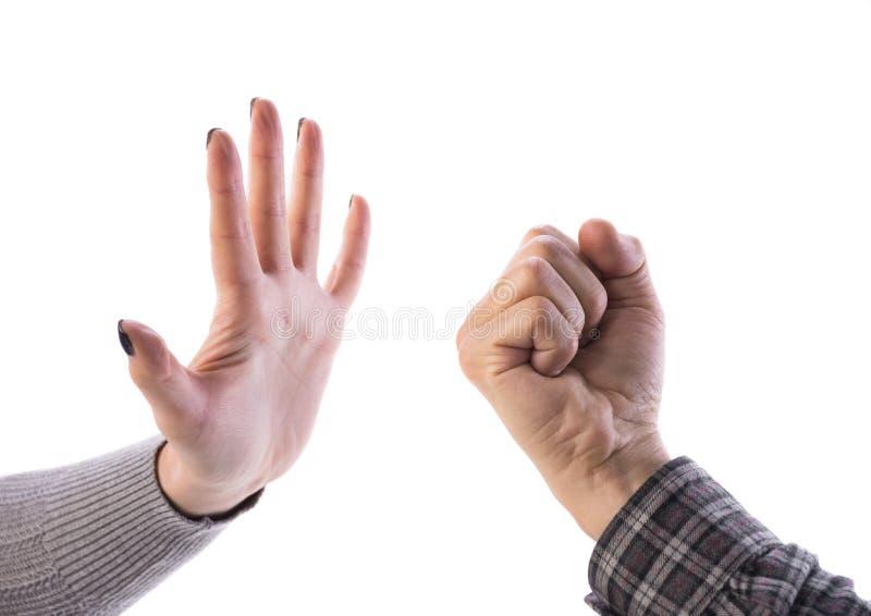Женщина делая стоп показывать, укомплектовать личным составом показывать кулак стоковые фотографии rf