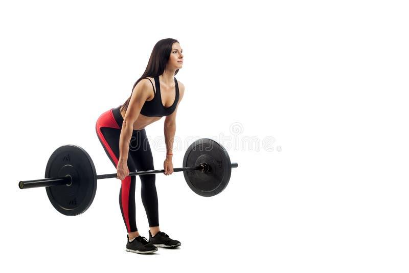 Женщина делая deadlift с штангой стоковое фото