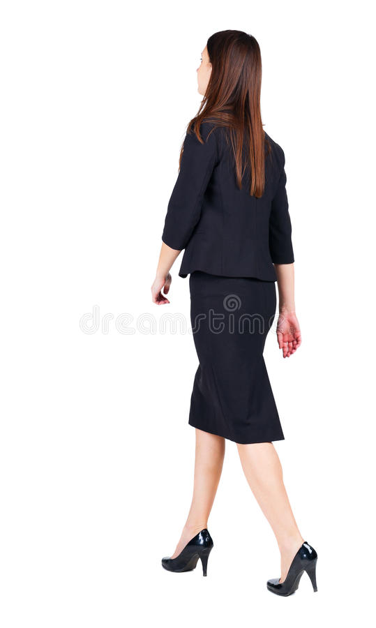 женщина дела гуляя задний взгляд стоковое изображение rf