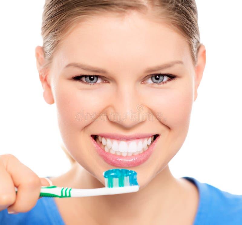 Женщина зубоврачебной заботы стоковое фото rf
