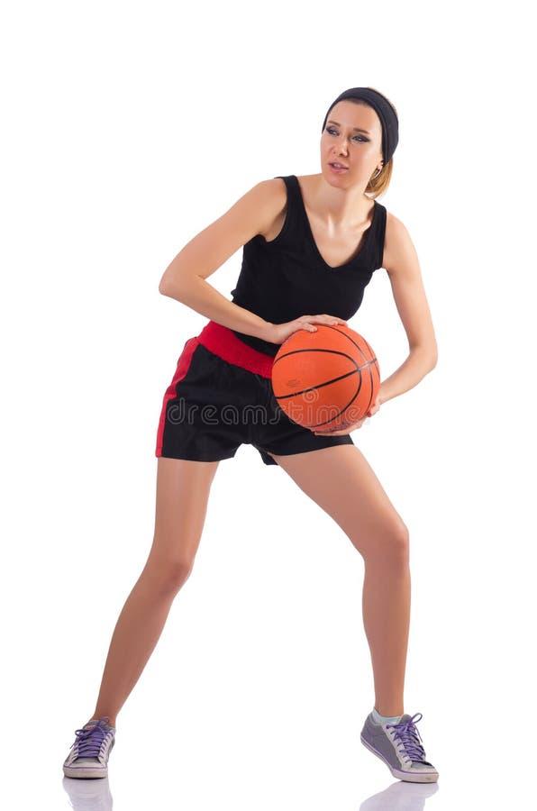Женщина играя баскетбол изолированный на белизне стоковое изображение