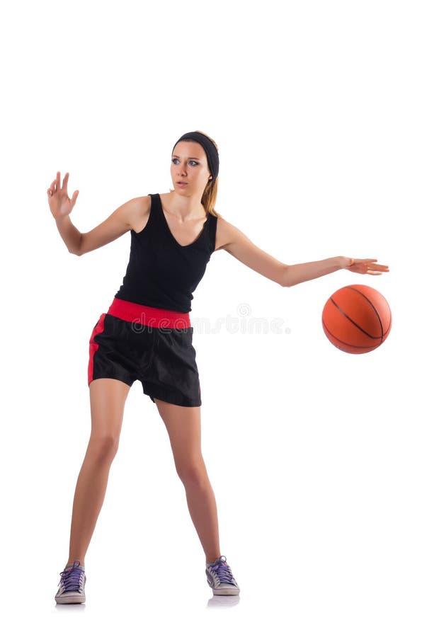 Женщина играя баскетбол изолированный на белизне стоковая фотография