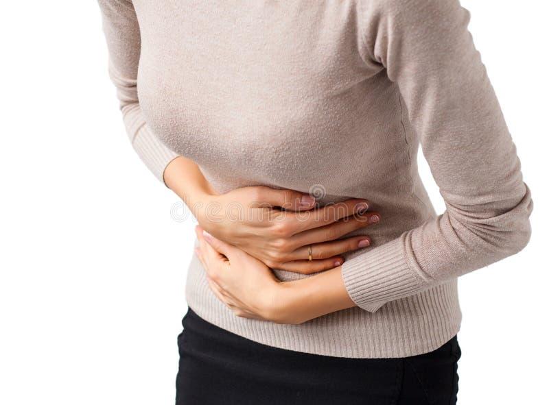 Женщина имея боль в животе стоковые изображения rf