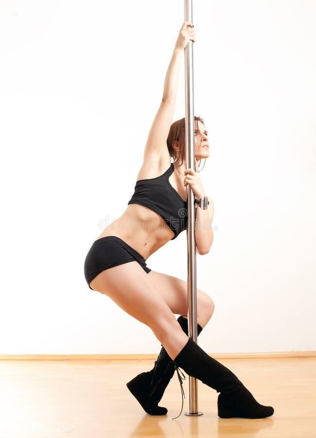 Женщина и полюс танцев стоковое изображение