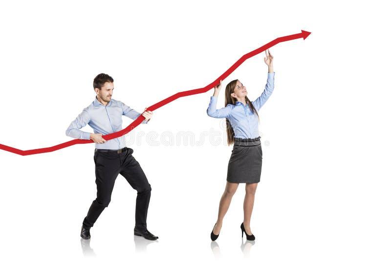 Женщина и человек с кривым статистик стоковое изображение