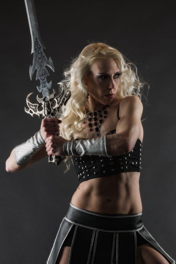 Женщина и шпага стоковые изображения rf