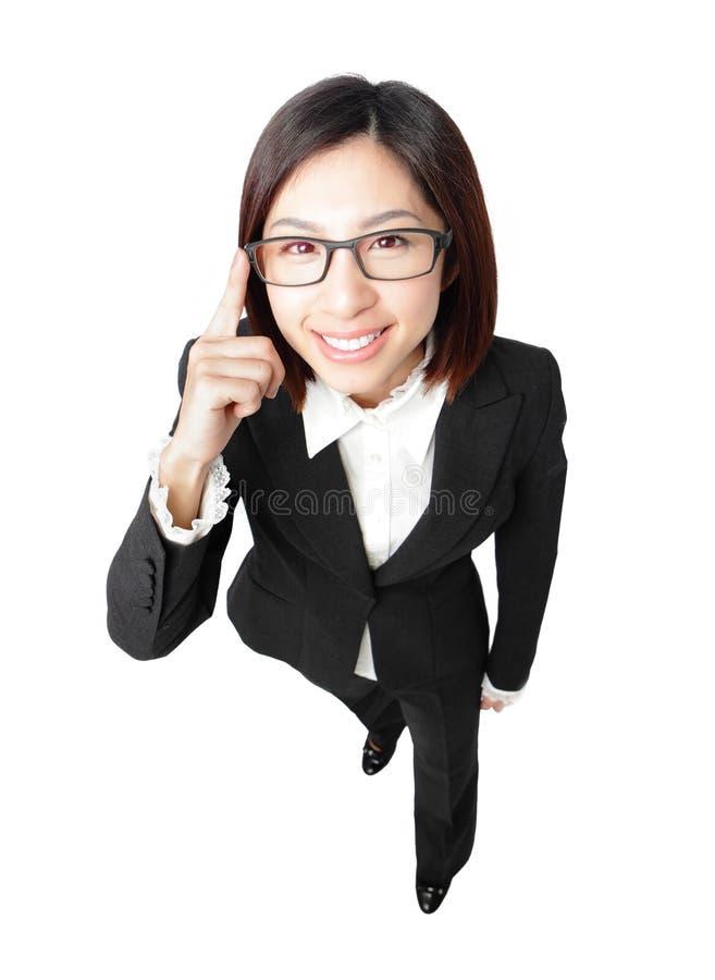 женщина касания eyeglasses глаза дела успешная стоковое изображение