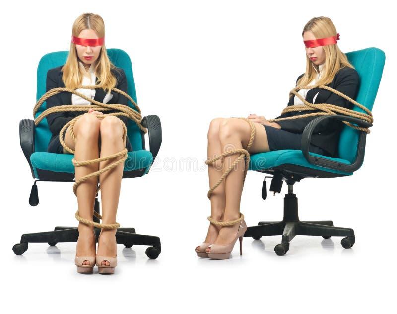 Женщина коммерсантки связанная вверх с веревочкой на белизне стоковая фотография