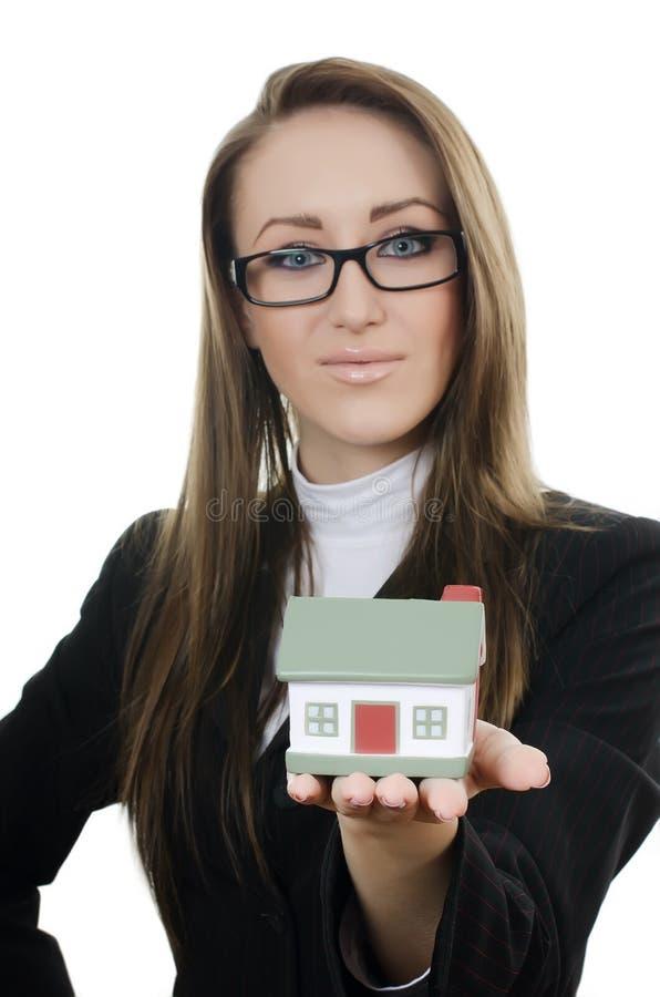 женщина коммерческого дома модельная малая стоковое фото rf