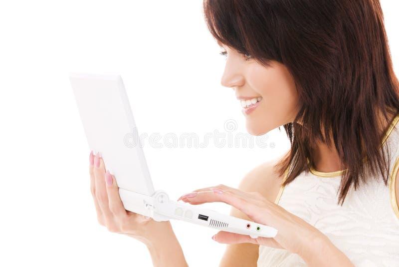 женщина компьтер-книжки компьютера счастливая стоковые изображения