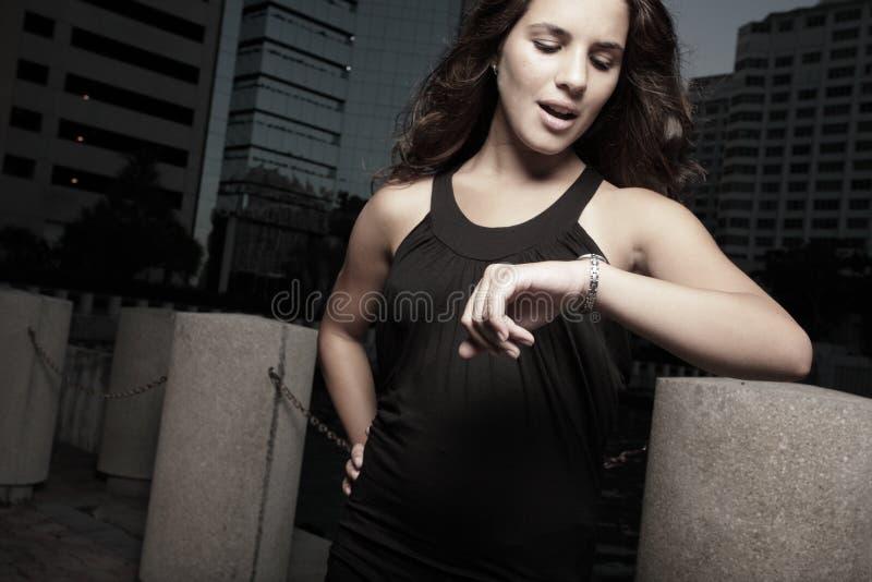 женщина контрольного времени стоковое фото rf