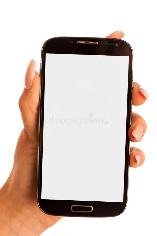 Женщина красоты используя и читающ умный изолированный телефон на белизне стоковое изображение