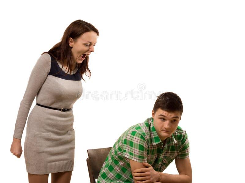Женщина крича на ее парне стоковая фотография rf