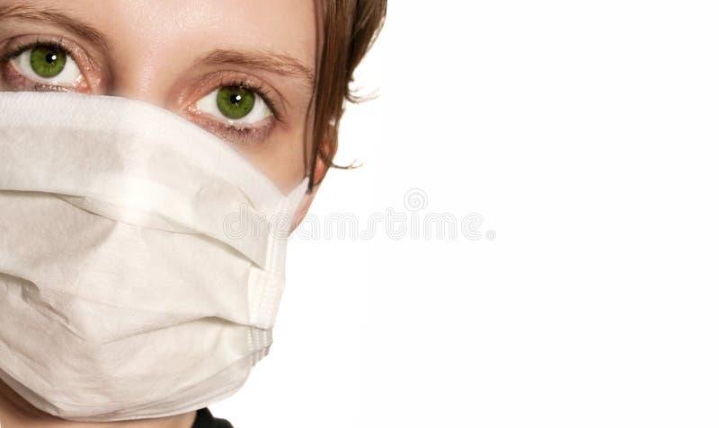 женщина маски медицинская нося стоковое изображение rf