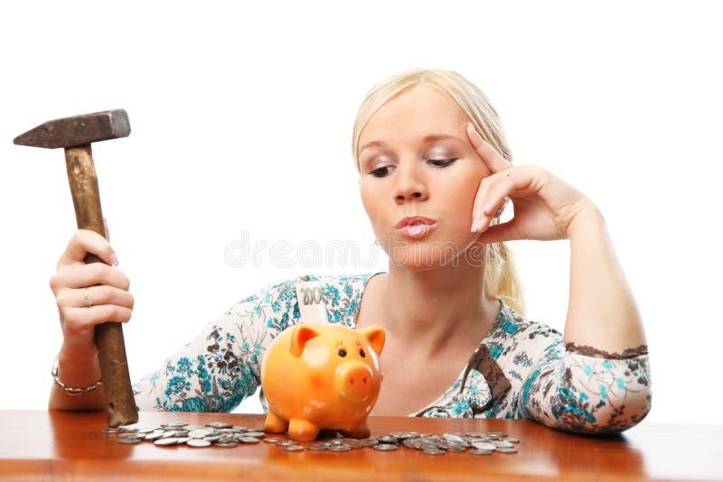 женщина молотка банка piggy стоковое фото rf