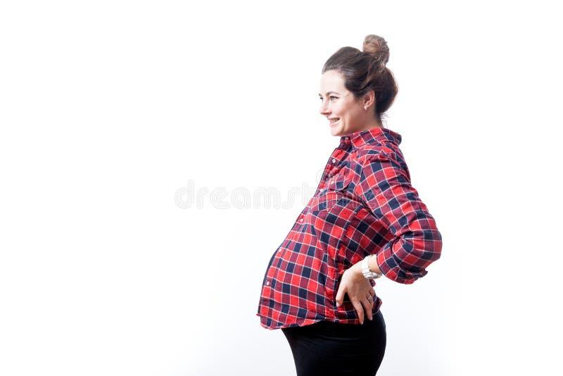 Женщина на ее последней беременности стоковое фото