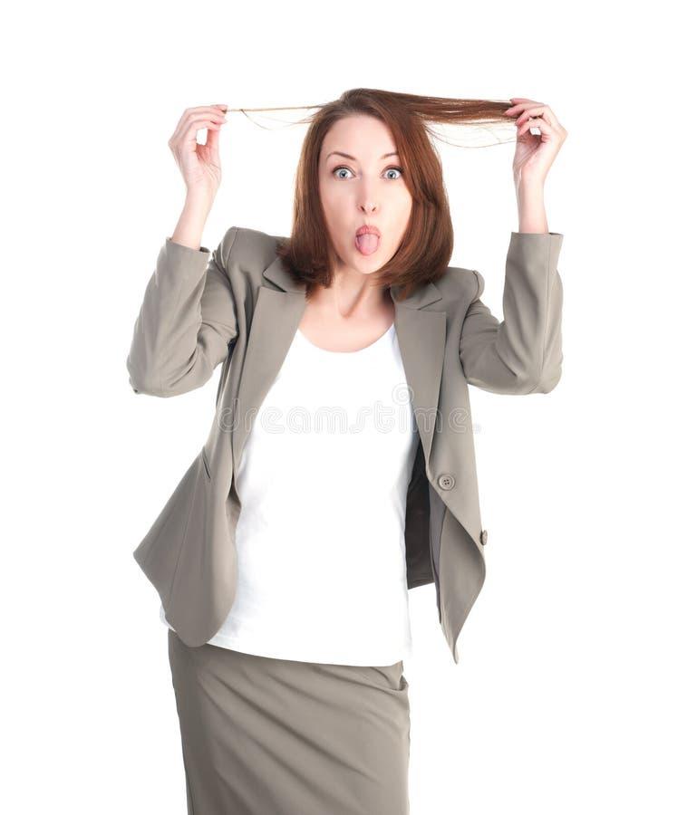 Женщина не совсем чистого дела показывая изолированный язык стоковое фото rf
