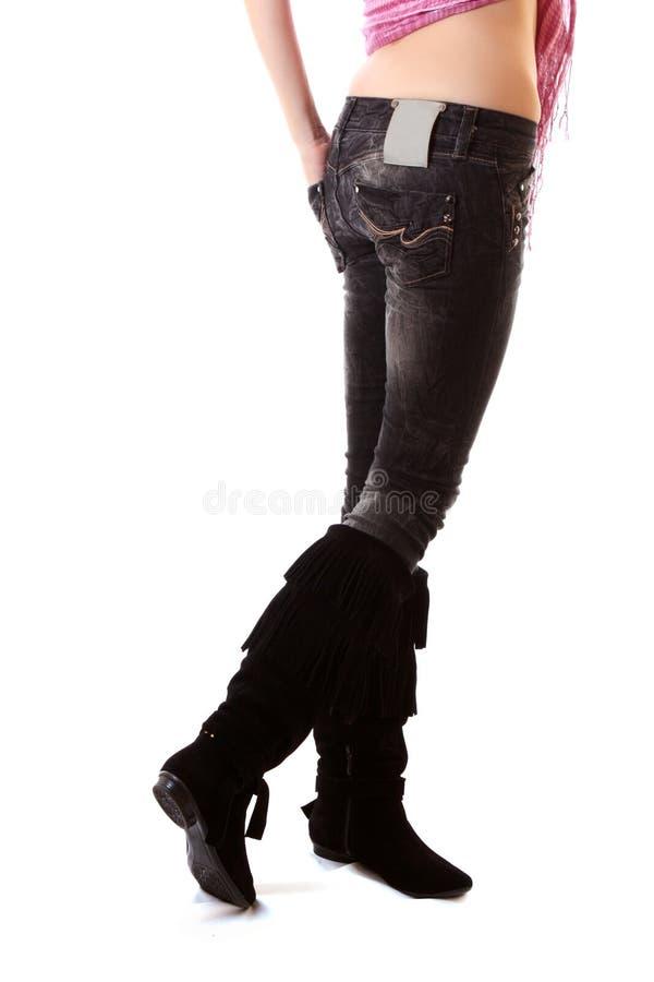 женщина ног джинсыов стоковое фото