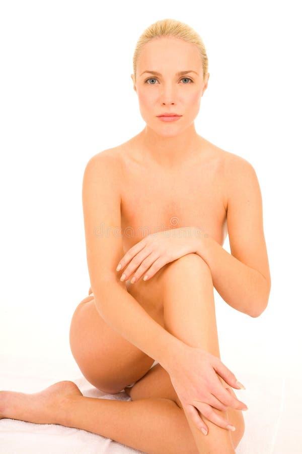 женщина обнажённого сидя стоковая фотография