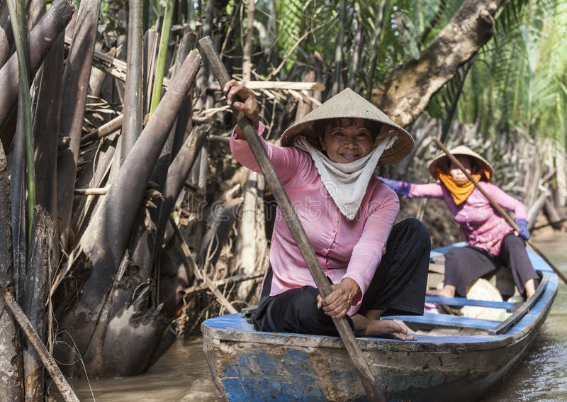 Женщина перепада Меконга стоковые изображения