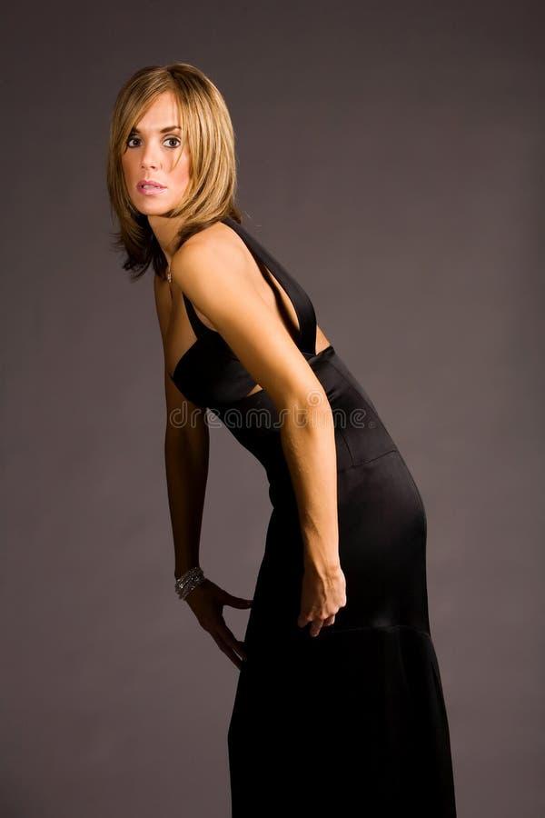 женщина платья милая стоковое изображение