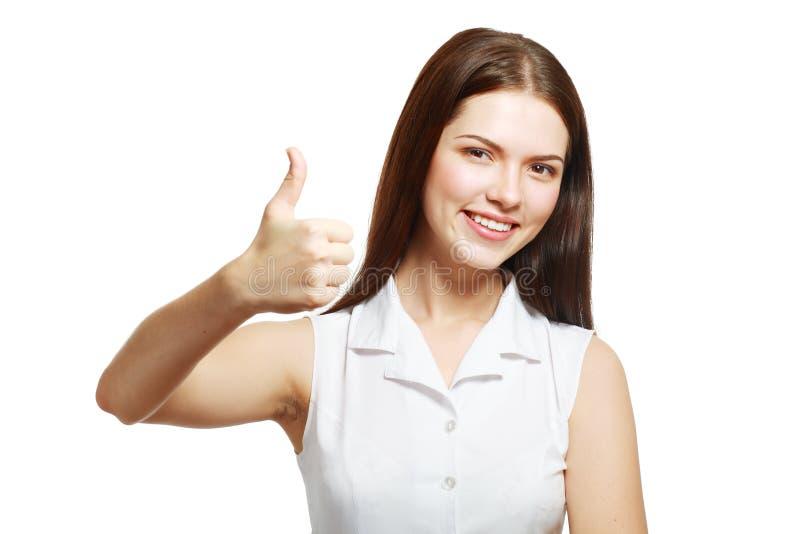 Женщина показывая большой палец руки вверх стоковые фотографии rf