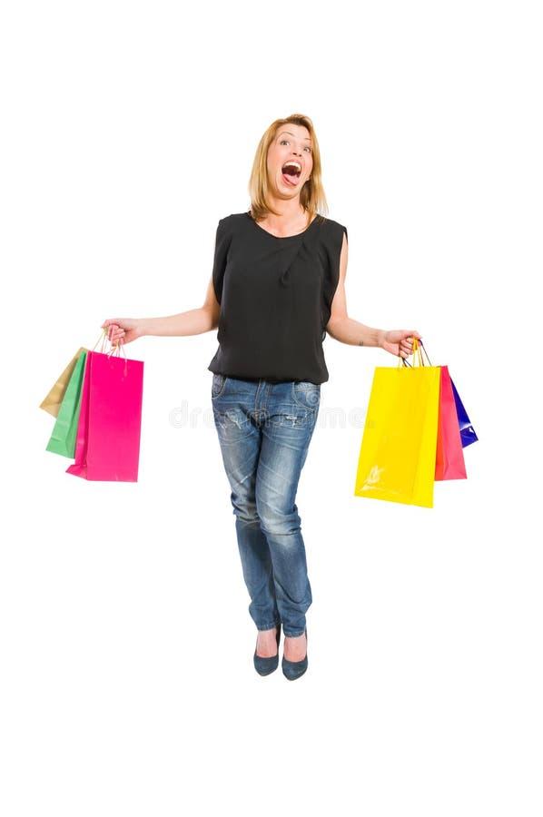 Женщина покупок действуя шальной стоковая фотография rf