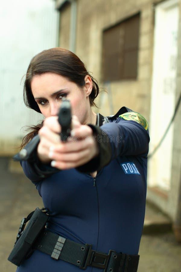 женщина полиций пистолета стоковая фотография rf