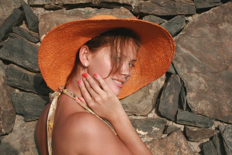 женщина померанца шлема стоковые изображения