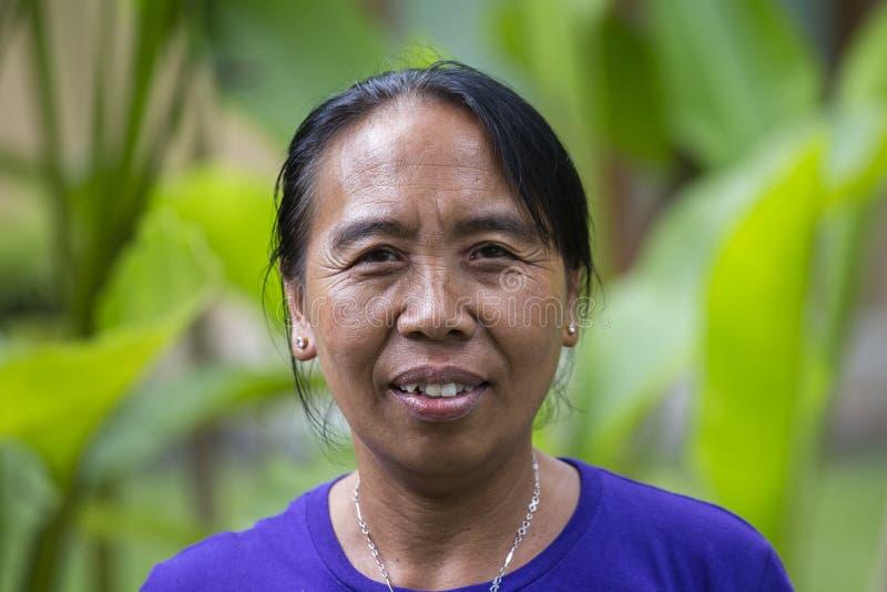Женщина портрета балийская в местном рынке в Ubud, Бали, Индонезии стоковое изображение