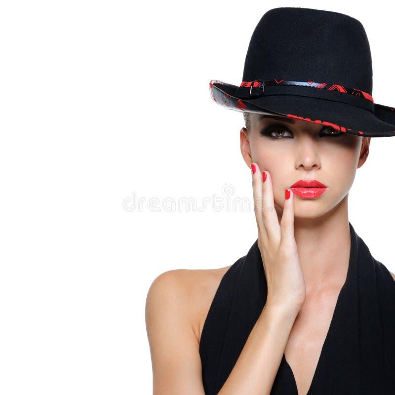 женщина портрета очарования предпосылки черная стоковое фото