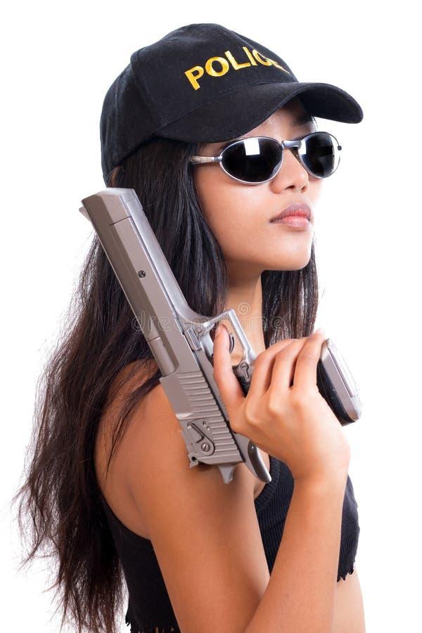 Женщина полиции с оружием стоковая фотография rf