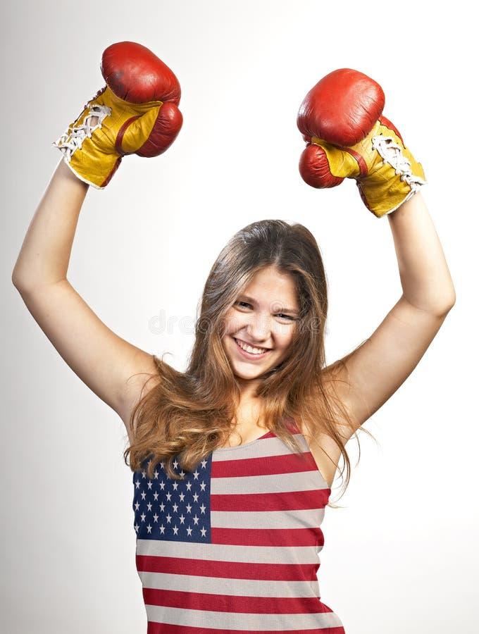 Женщина празднуя для ее succes с флагом США стоковое изображение rf
