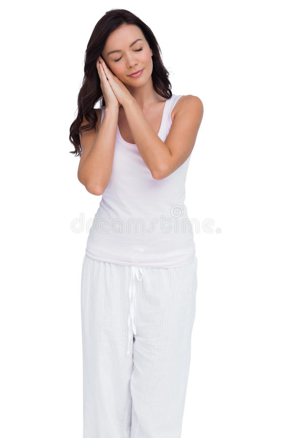 Женщина претендуя спать стоковое изображение
