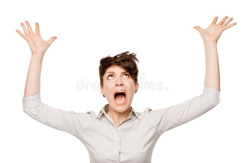 Женщина представляя в панике на белой предпосылке стоковые фото