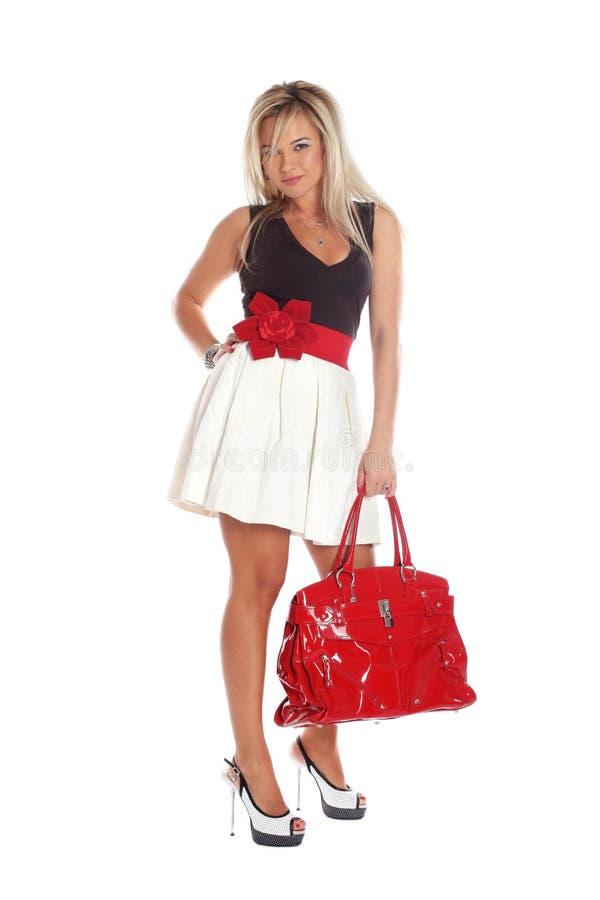 Женщина при красный мешок изолированный на белизне стоковая фотография rf