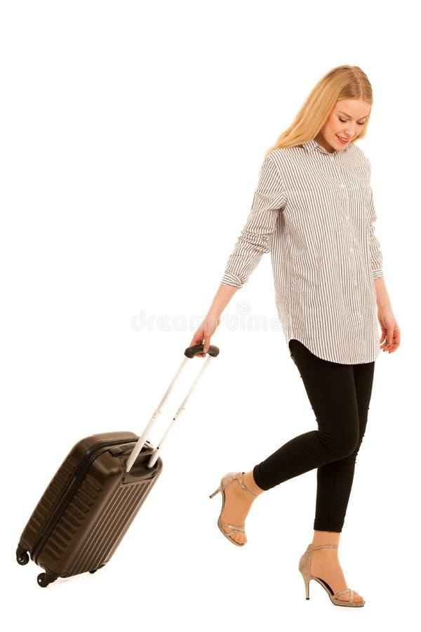 Женщина при путешествовать чемодана изолированный над белой предпосылкой стоковое фото rf