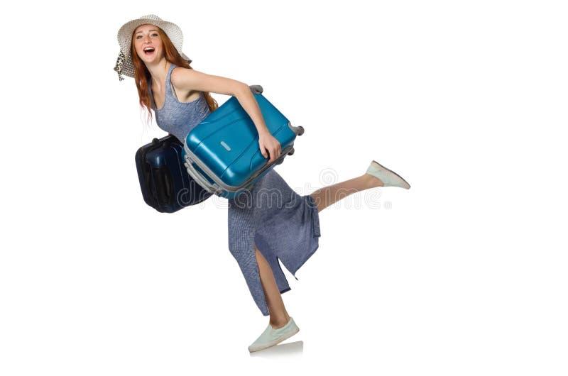 Женщина при чемодан изолированный на белизне стоковые изображения