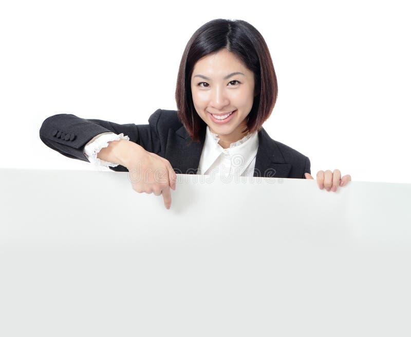женщина пустого дела афиши счастливая показывая стоковое фото