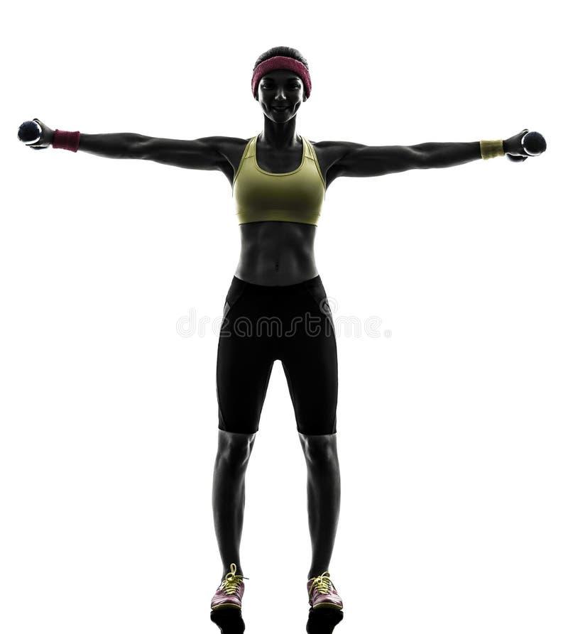 Женщина работая вес разминки фитнеса тренируя s стоковые фото