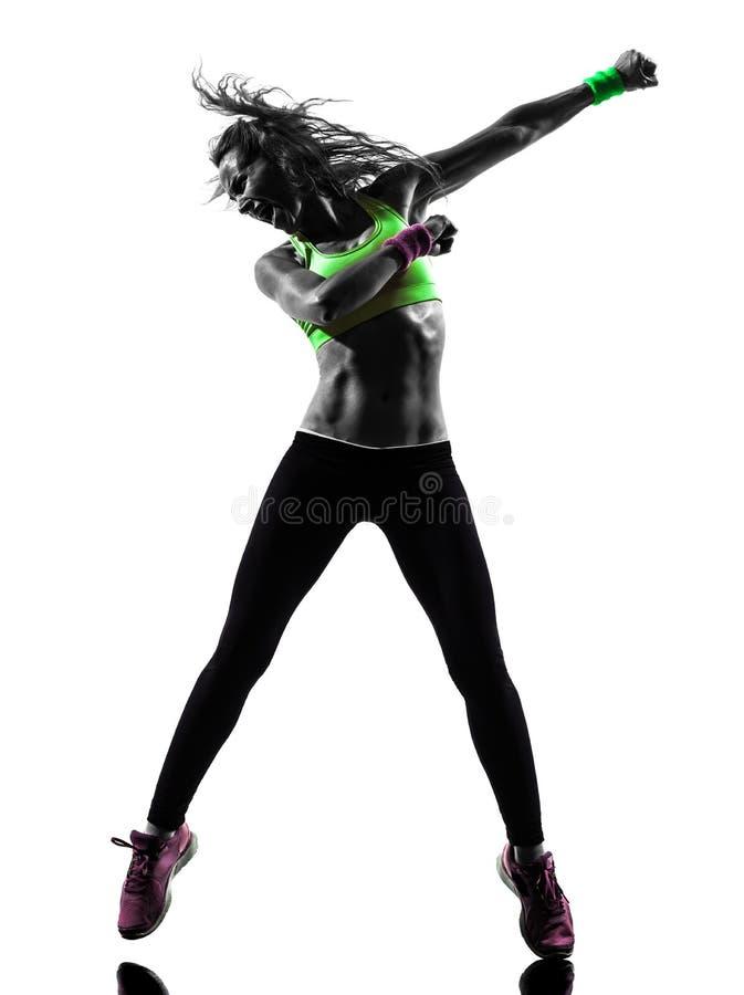 Женщина работая силуэт танцев zumba фитнеса стоковые фото