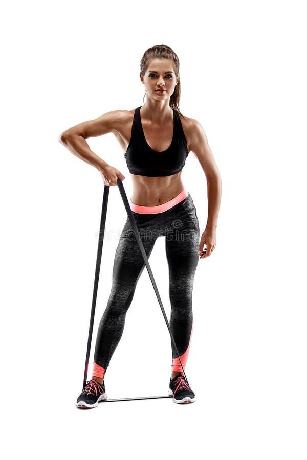 Женщина работая сопротивление фитнеса соединяет в силуэт студии изолированный на белой предпосылке стоковые изображения rf