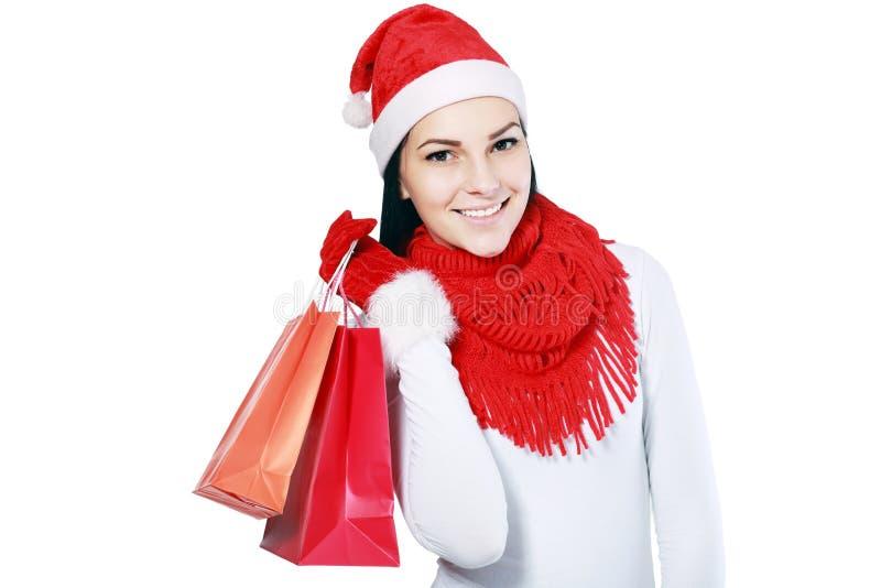 Женщина рождества с сумками стоковая фотография