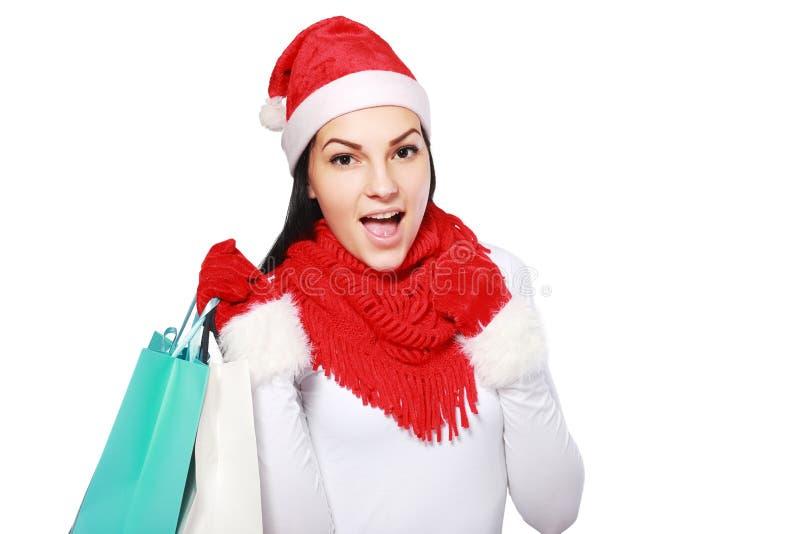 Женщина рождества с сумками стоковое изображение