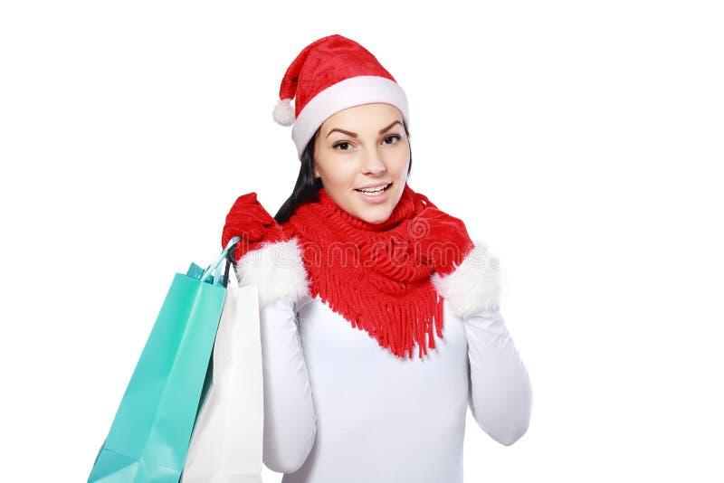 Женщина рождества с сумками стоковые изображения rf