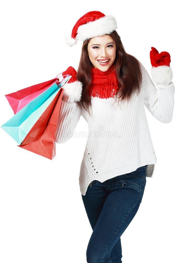 Женщина рождества с сумками стоковые изображения